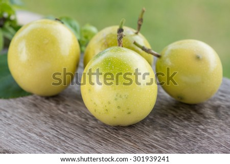 Fresh passion fruit on wood table. - stock photo