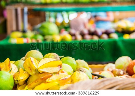 Fresh passion fruits selling on the fruit market by the side of the road on the island of Oahu, Hawaii. - stock photo