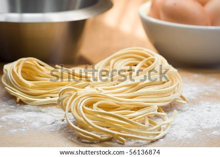 Fresh pasta on table - stock photo