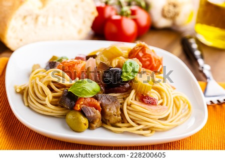 fresh pasta with a tasty homemade caponata.  - stock photo