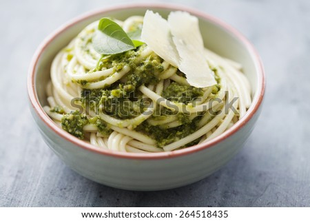fresh pasta with basil pesto - stock photo