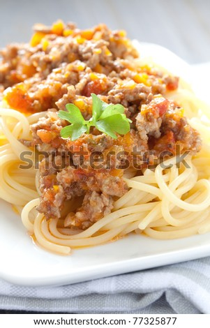 fresh pasta with bolognese sauce - stock photo