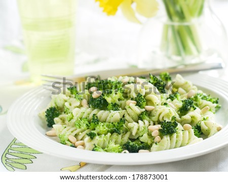 Fresh pasta with broccoli, pesto and pine nuts, selective focus  - stock photo