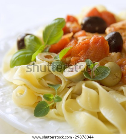 fresh pasta with olives and basil - stock photo