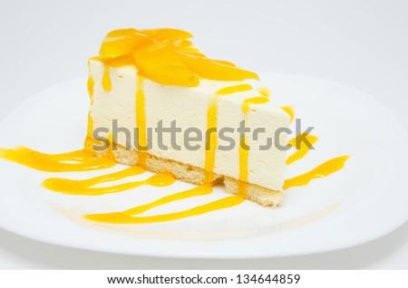 fresh peach cheese cake with syrup, closeup shot - stock photo