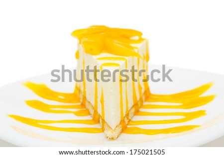 fresh peach cheese cake with syrup, narrow focus - stock photo