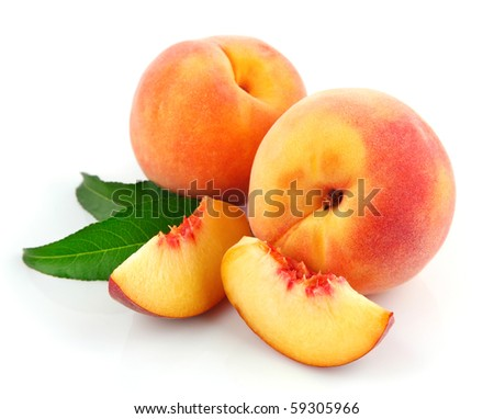 fresh peach fruits with green leaves isolated on white background - stock photo