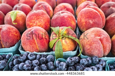 Fresh peaches and blueberries at local farm market. - stock photo