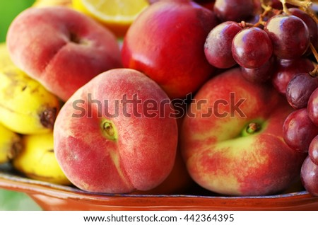 Fresh peaches and grappes, closeup - stock photo