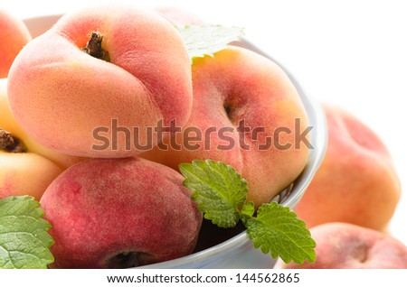fresh peaches in the bowl