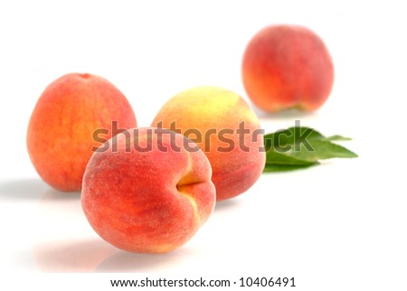 Fresh peaches - isolated on white - stock photo