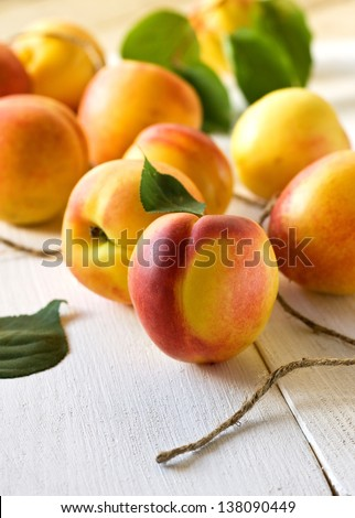 fresh peaches ( nectarine) on a wooden board - stock photo