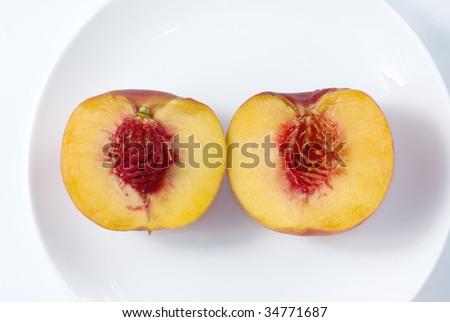 Fresh peaches on white dish with selective focus - stock photo