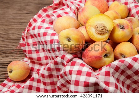Fresh peaches on wooden background - stock photo