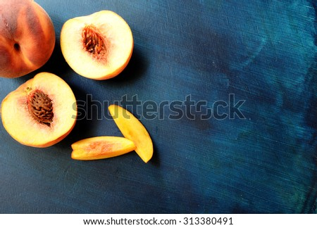 Fresh peaches over dark blue background. Top view. copy space - stock photo