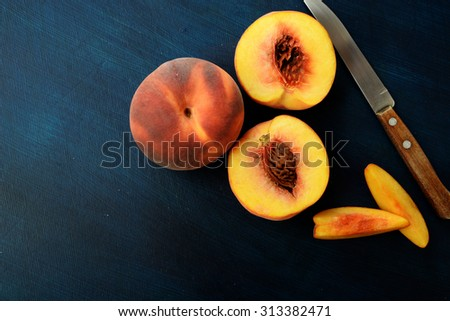 Fresh peaches over dark blue background. Top view.  copy space.Nature fruit concept. - stock photo