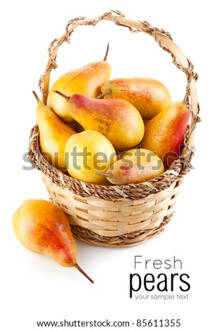 fresh pear fruits in the basket isolated on white background - stock photo