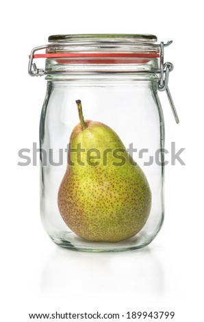 Fresh pear in a canning jar - stock photo