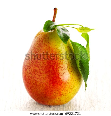 Fresh pear with green leaves isolated on white background - stock photo