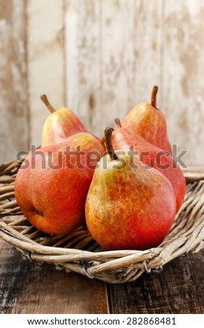 Fresh pears on wicker tray, copy space - stock photo