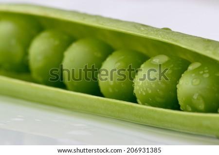 Fresh peas - stock photo