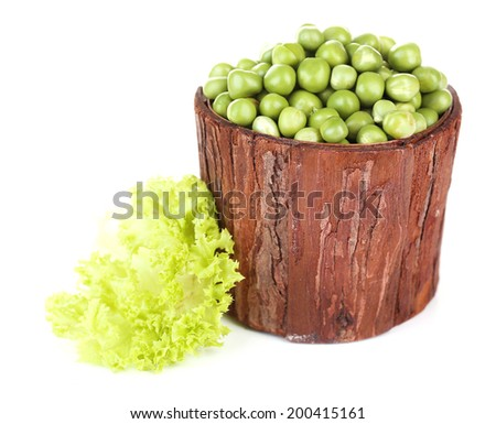 Fresh peas in bowl, isolated on white - stock photo