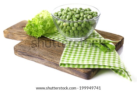 Fresh peas in glass bowl on wooden board, isolated on white - stock photo