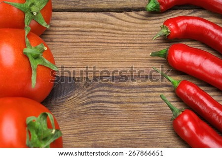 Fresh Peppers And Tomatoes On Wooden Rustic Table. Ingredients for Soup, Salad, Paste - stock photo