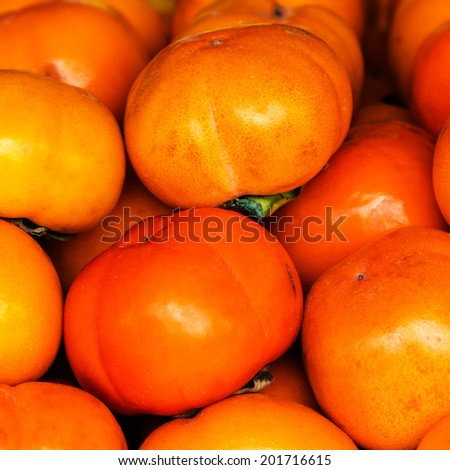 Fresh Persimmon fruit  background close up.