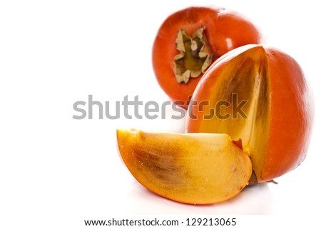 fresh persimmon fruit on a white background