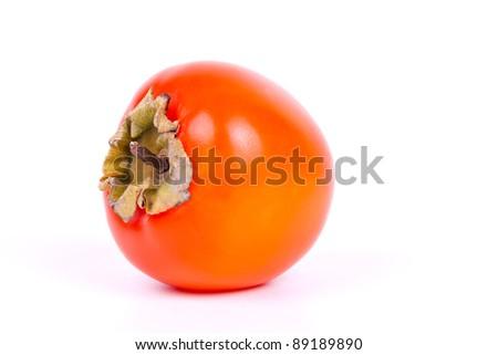 fresh persimmon on white background in studio - stock photo