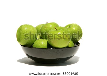 fresh picked green granny smith apples in a bowl with water drops isolated on white with room for your text - stock photo
