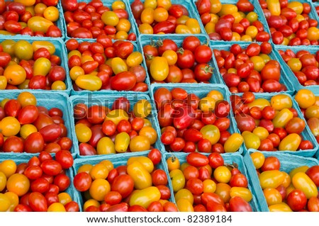 Fresh picked red and yellow cherry tomatoes on display at the farmer's market