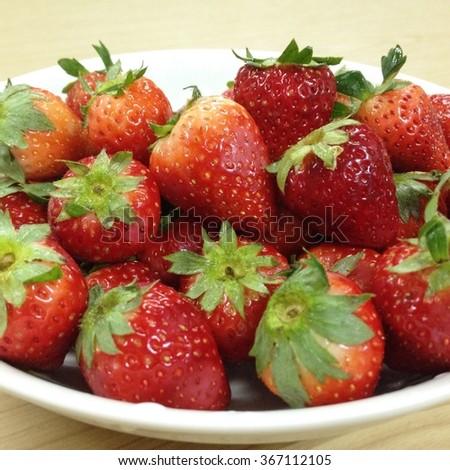 Fresh picked strawberries. - stock photo