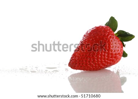 fresh picked strawberry with morning dew drops on white with reflections - stock photo