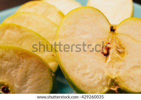 Fresh pieces of chopped apple close-up on plate - stock photo