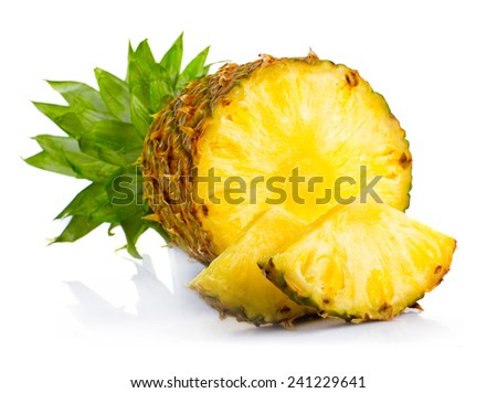 Fresh pineapple fruits with cut and green leaves isolated on white background  - stock photo
