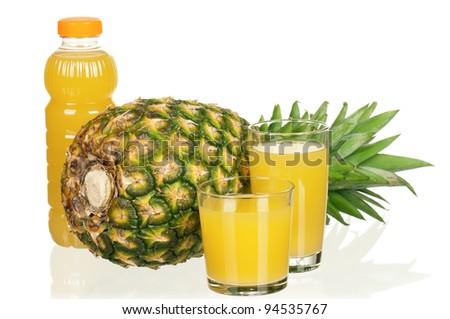 Fresh pineapple juice and ripe pineapple on white background - stock photo