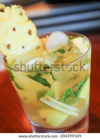 Fresh Pineapple Mojito extreme close up - stock photo