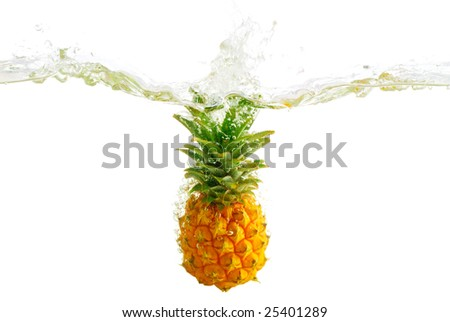 Fresh pineapple splash in water - stock photo