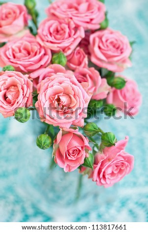 fresh pink roses on a table. - stock photo