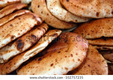 Fresh Pita breads in a bakery. food background.
