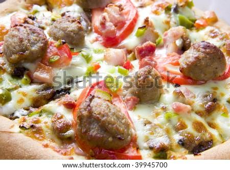 Fresh pizza on white ground. close up - stock photo