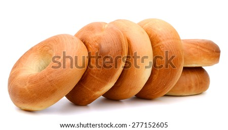 fresh plain bagels roll up isolated on white  - stock photo