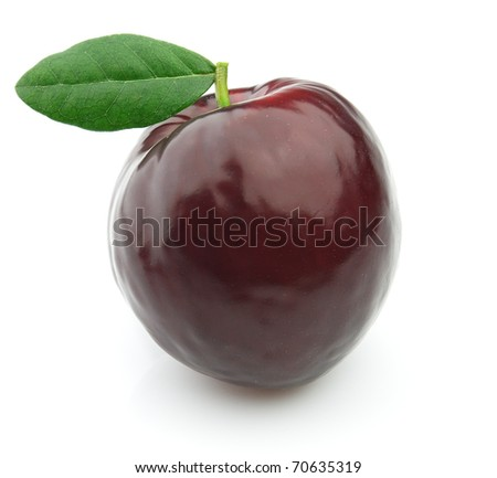 Fresh plum with leaves - stock photo