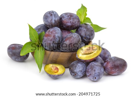 fresh plums in a bowl on white background - stock photo