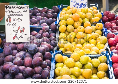 Fresh plums on sale at a market stall