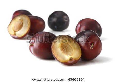 Fresh plums on the white background