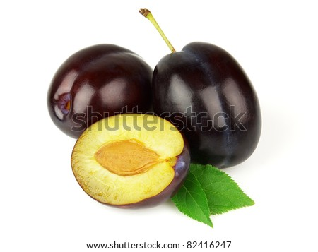 Fresh plums with leaves - stock photo
