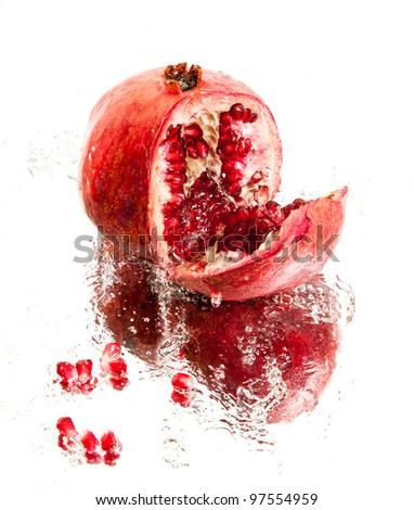 Fresh pomegranate in water splash - stock photo